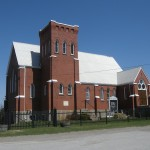 Coulson's Hill, one of two churches in town, Highway 11